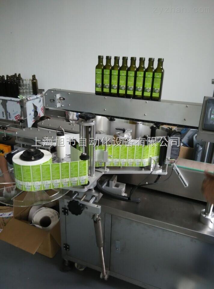 上海橄榄油瓶双侧面贴标机 优质橄榄油贴标机